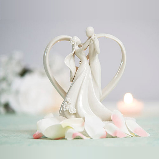 groom dancing with bride cake topper