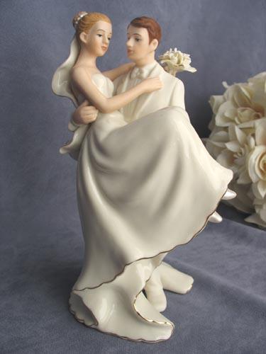 Off White Groom Holding Bride