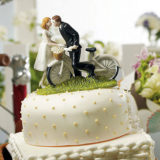 """A Kiss Above"" Bicycle Bride And Groom Couple Figurine"