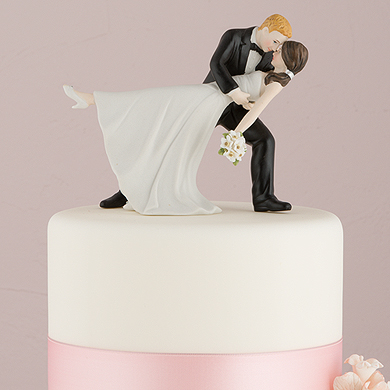 a romantic dip dancing bride and groom couple figurine