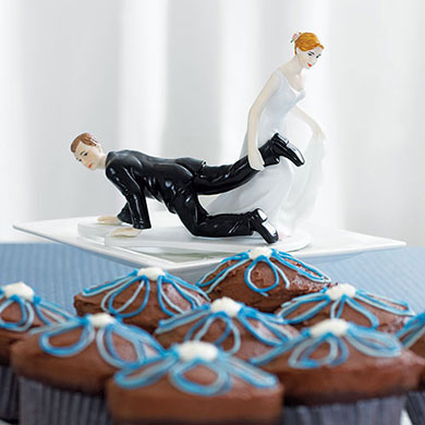 comical couple with the bride having the upper hand cake topper3