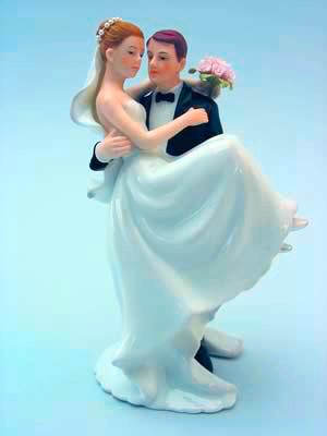Caucasian Groom Holding Bride